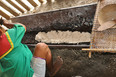 preparing to wring out the moisture from the cassava